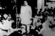 Dr. Ambedkar making a speech. V. V. Giri among others are seen around