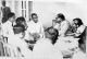 Dr. Ambedkar with Savita Ambedkar in conversion with some people